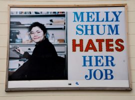 Sculpture/billboard Melly Shum Hates Her Job (1990) by Ken Lum, Witte de Withstraat in Rotterdam/The Netherlands.